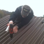Member Shef Robotham does some repairs on the observatory roof